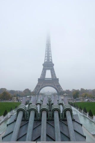 A different perspective of the iconic Eiffel Tower from Place de Trocadéro on a foggy day.