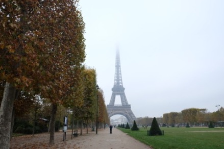 A snapshot of the Eiffel Tower from Champ de Mars in full fall color.